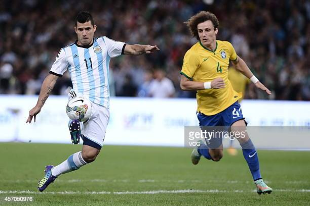 David Luiz of Brazil and Sergio Aguero of Argentina battle for the ball during a match between Argentina and Brazil as part of 2014 Super Clasico at...