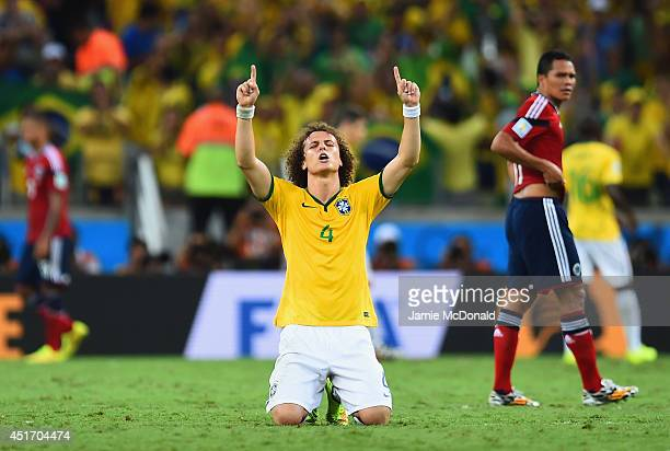 David Luiz of Brazil celebrates after defeating Colombia 21 during the 2014 FIFA World Cup Brazil Quarter Final match between Brazil and Colombia at...