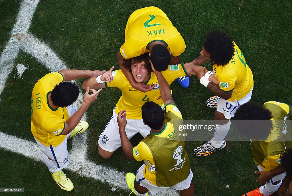 David Luiz of Brazil celebrates scoring his team's first goal with teammates during the 2014 FIFA World Cup Brazil round of 16 match between Brazil and Chile at Estadio Mineirao on June 28, 2014 in Belo Horizonte, Brazil.