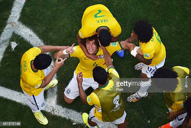 David Luiz of Brazil celebrates scoring his team's first goal with teammates during the 2014 FIFA World Cup Brazil round of 16 match between Brazil...