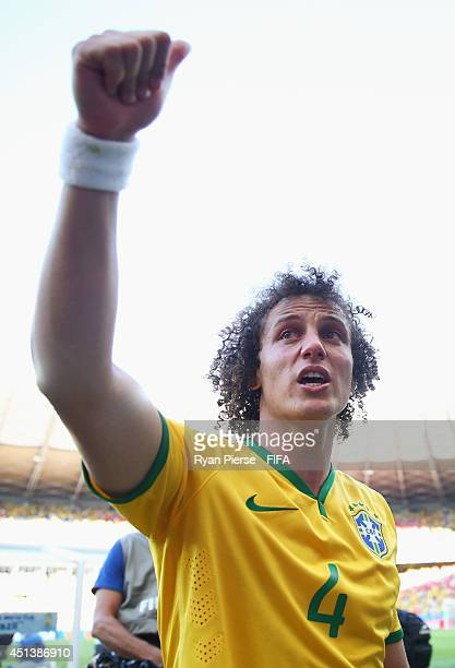 David Luiz of Brazil celebrates the win through a penalty shootout after the 2014 FIFA World Cup Brazil Round of 16 match between Brazil and Chile at...