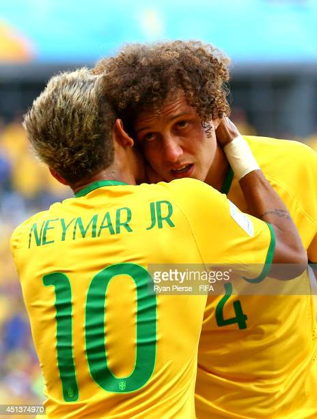 David Luiz of Brazil celebrates with Neymar of Brazil after scoring the team's first goal during the 2014 FIFA World Cup Brazil Round of 16 match...