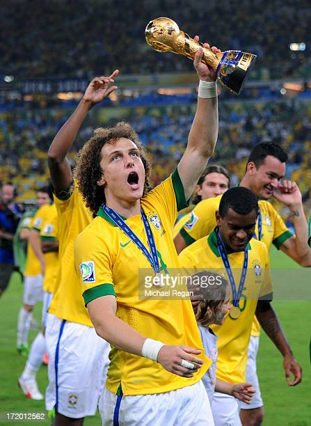 David Luiz of Brazil celebrates with the trophy at the end of the FIFA Confederations Cup Brazil 2013 Final match between Brazil and Spain at...