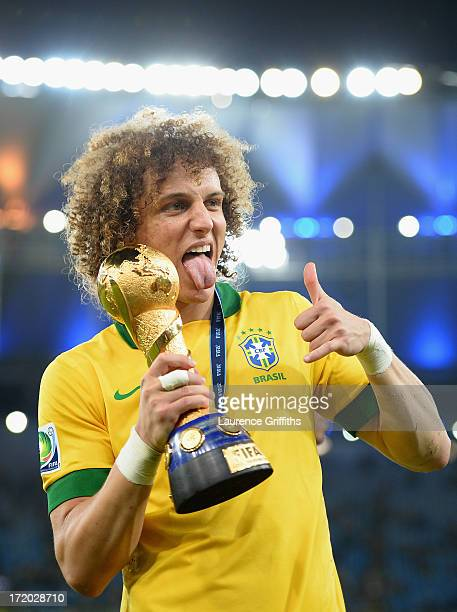 David Luiz of Brazil celebrates with trophy after victory in the FIFA Confederations Cup Brazil 2013 Final match between Brazil and Spain at Maracana...