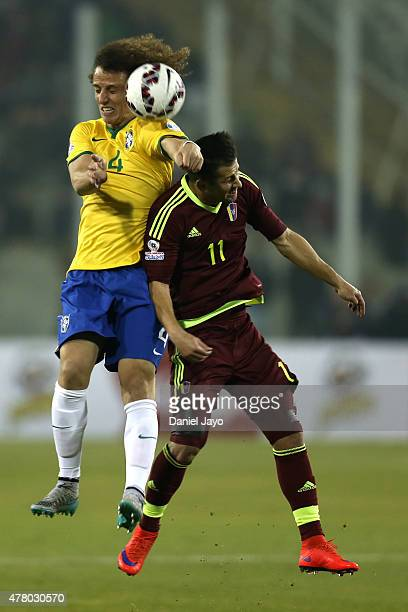David Luiz of Brazil goes for a header with Cesar Gonzalez of Venezuela during the 2015 Copa America Chile Group C match between Brazil and Venezuela...