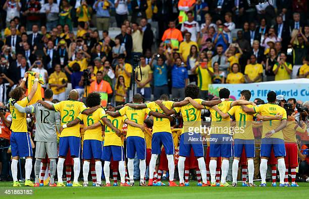 David Luiz of Brazil holds the shirt of injured teammate Neymar at the national anthem prior to the 2014 FIFA World Cup Brazil Semi Final match...