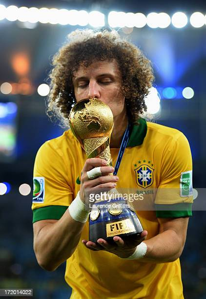 David Luiz of Brazil kisses the trophy at the end of the FIFA Confederations Cup Brazil 2013 Final match between Brazil and Spain at Maracana on June...