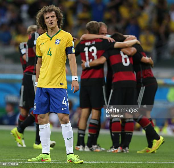David Luiz of Brazil looks on after Germany score a fifth goal during the 2014 FIFA World Cup Brazil Semi Final match between Brazil and Germany at...