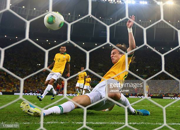 David Luiz of Brazil makes a goal-line clearance during the FIFA Confederations Cup Brazil 2013 Final match between Brazil and Spain at Maracana on...