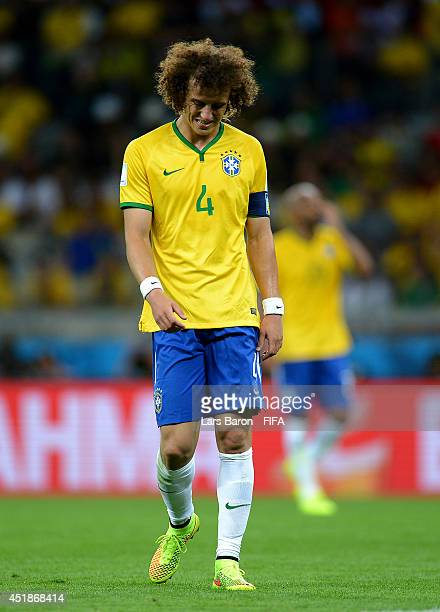 David Luiz of Brazil reacts after conceding the seventh goal to Germany during the 2014 FIFA World Cup Brazil Semi Final match between Brazil and...