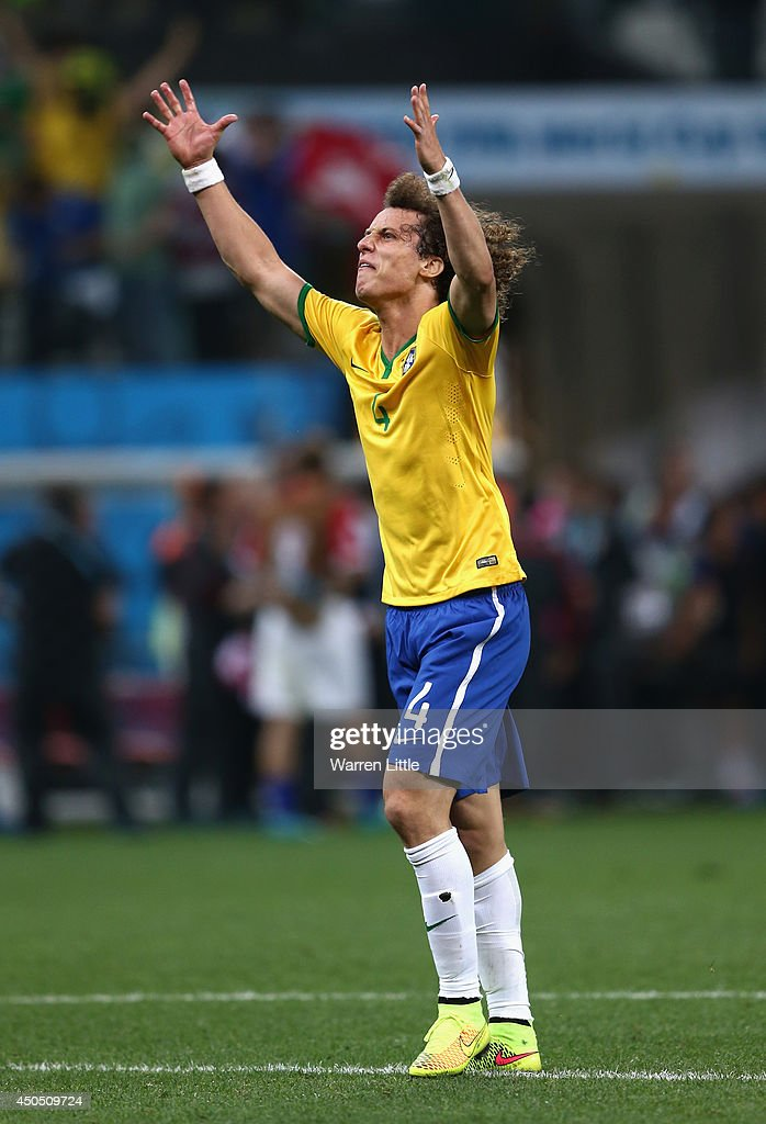 David Luiz of Brazil reacts to a goal by Oscar (not pictured) in the second half during the 2014 FIFA World Cup Brazil Group A match between Brazil and Croatia at Arena de Sao Paulo on June 12, 2014 in Sao Paulo, Brazil.