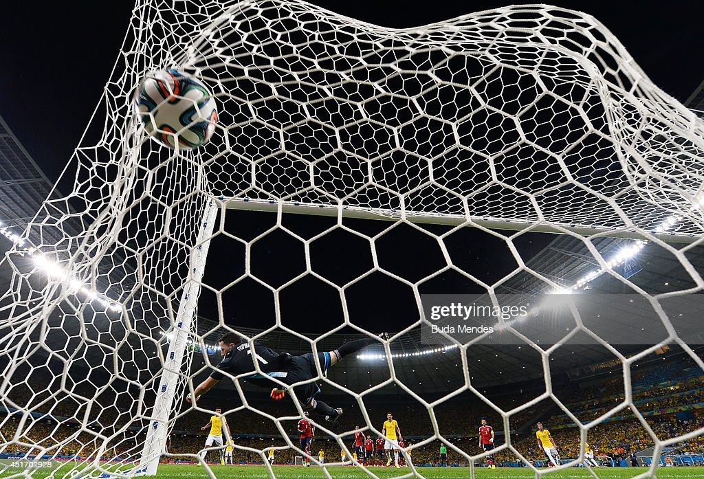David Luiz of Brazil scores his team's second goal on a free kick past David Ospina of Colombia during the 2014 FIFA World Cup Brazil Quarter Final match between Brazil and Colombia at Castelao on July 4, 2014 in Fortaleza, Brazil.