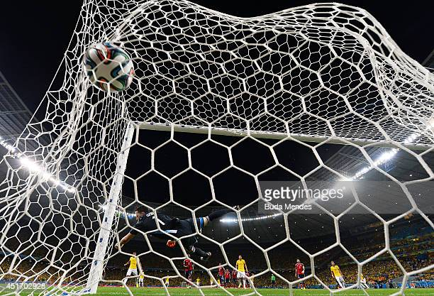 David Luiz of Brazil scores his team's second goal on a free kick past David Ospina of Colombia during the 2014 FIFA World Cup Brazil Quarter Final...