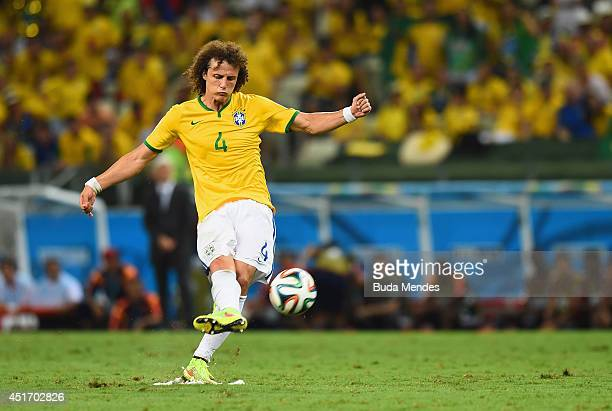 David Luiz of Brazil scores his team's second goal on a free kick during the 2014 FIFA World Cup Brazil Quarter Final match between Brazil and...