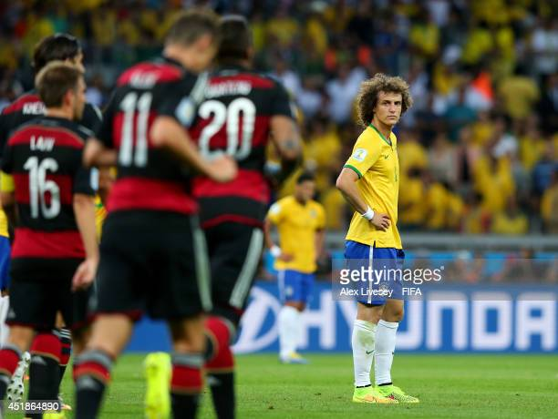 David Luiz of Brazil shows his dejection after conceding fourth goal to Germany during the 2014 FIFA World Cup Brazil Semi Final match between Brazil...