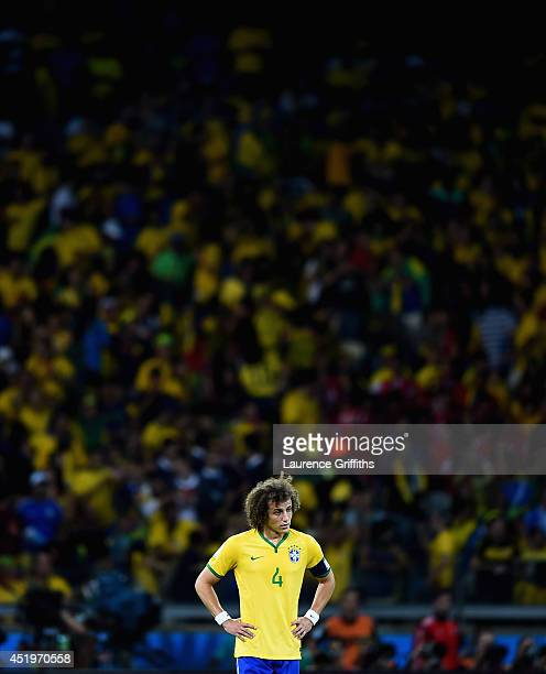 David Luiz of Brazil shows his disappointment after Germany's sixth goal during the 2014 FIFA World Cup Brazil Semi Final match between Brazil and...