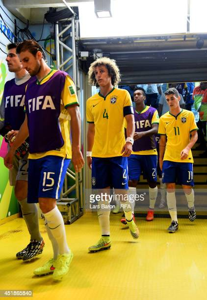 David Luiz of Brazil walks in the tunnel after the first half during the 2014 FIFA World Cup Brazil Semi Final match between Brazil and Germany at...