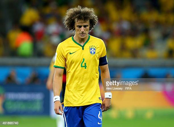 David Luiz of Brazil walks off the pitch after the first half during the 2014 FIFA World Cup Brazil Semi Final match between Brazil and Germany at...