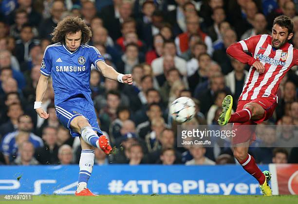 David Luiz of Chelsea and Adrian Lopez Alvarez of Atletico Madrid in action during the UEFA Champions League semi final second leg match between...