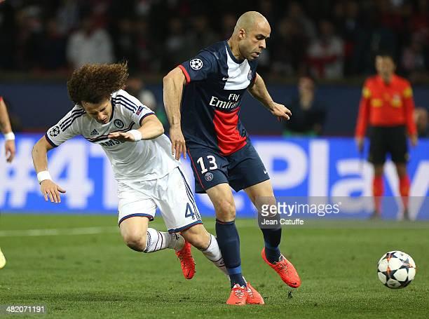 David Luiz of Chelsea and Alex Dias Da Costa of PSG in action during the UEFA Champions League quarter final match between Paris SaintGermain FC and...