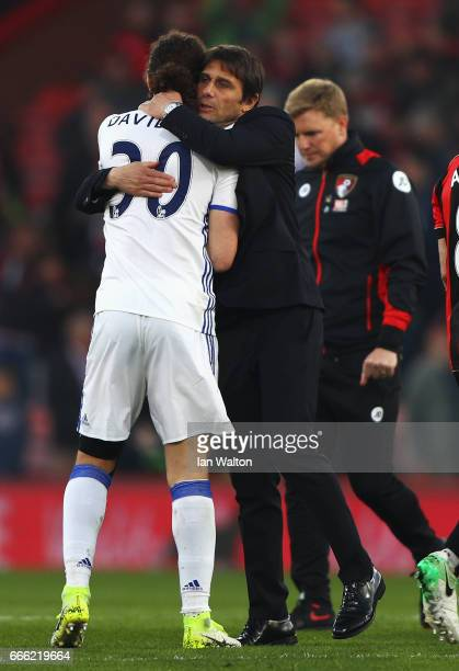 David Luiz of Chelsea and Antonio Conte Manager of Chelsea embrace after the Premier League match between AFC Bournemouth and Chelsea at Vitality...
