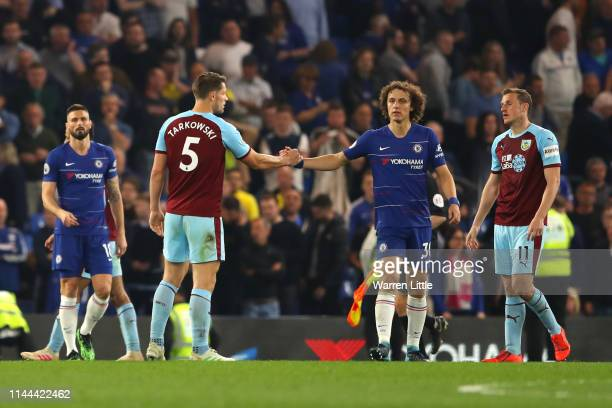 David Luiz of Chelsea and Ashley Barnes of Burnley clash after the match during the Premier League match between Chelsea FC and Burnley FC at...