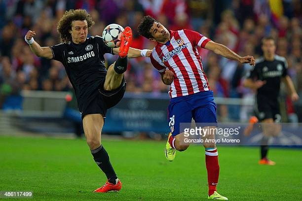 David Luiz of Chelsea and Diego Costa of Club Atletico de Madrid battle for the ball during the UEFA Champions League Semi Final first leg match...