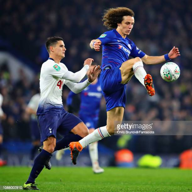 David Luiz of Chelsea and Erik Lamela of Tottenham Hotspur battle for the ball during the Carabao Cup SemiFinal Second Leg match between Chelsea and...