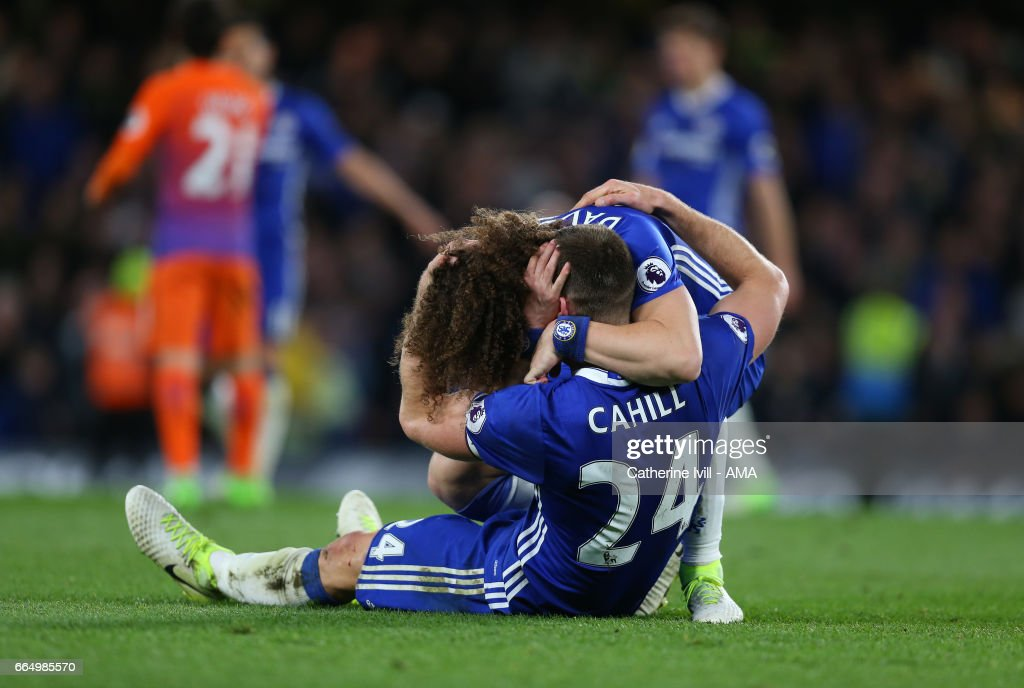 David Luiz of Chelsea and Gary Cahill of Chelsea celebrate the win during the Premier League match between Chelsea and Manchester City at Stamford Bridge on April 5, 2017 in London, England.