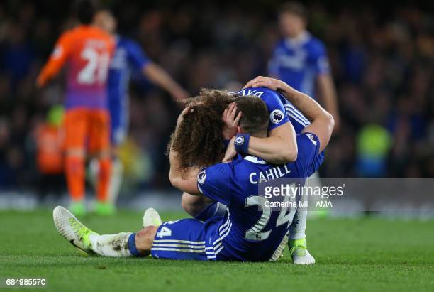 David Luiz of Chelsea and Gary Cahill of Chelsea celebrate the win during the Premier League match between Chelsea and Manchester City at Stamford...