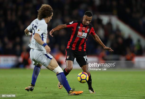 David Luiz of Chelsea and Junior Stanislas of AFC Bournemouth battle for possession during the Premier League match between AFC Bournemouth and...