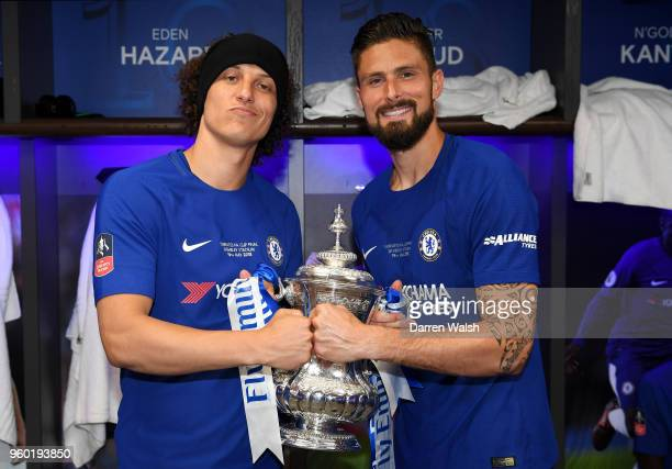 David Luiz of Chelsea and Olivier Giroud of Chelsea pose with the Emirates FA Cup trophy following their sides victory in The Emirates FA Cup Final...