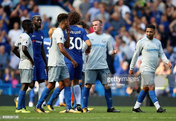 David Luiz of Chelsea and Wayne Rooney of Everton exchange words after during the Premier League match between Chelsea and Everton at Stamford Bridge...