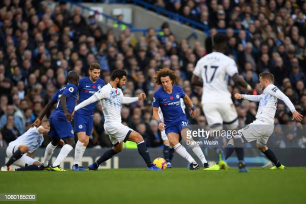 David Luiz of Chelsea battles for possession with Andre Gomes of Everton during the Premier League match between Chelsea FC and Everton FC at...