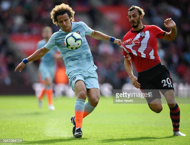 David Luiz of Chelsea battles for possession with Manolo Gabbiadini of Southampton during the Premier League match between Southampton FC and Chelsea...