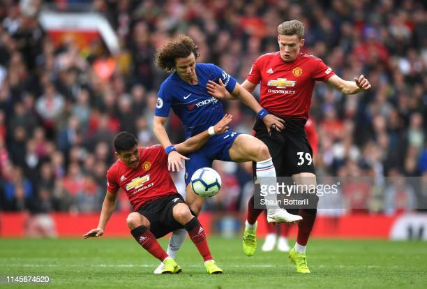 David Luiz of Chelsea battles with Alexis Sanchez and Scott McTominay of Manchester United during the Premier League match between Manchester United...