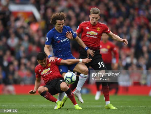 David Luiz of Chelsea battles with Alexis Sanchez and Scott McTominay during the Premier League match between Manchester United and Chelsea FC at Old...