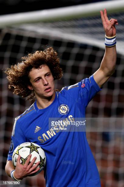 David Luiz of Chelsea celebrates after scoring the opening goal from the penalty spot during the UEFA Champions League group E match between Chelsea...