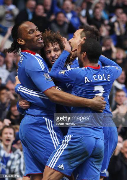 David Luiz of Chelsea celebrates with Didier Drogba John Terry and Ashley Cole as he scores their first goal during the Barclays Premier League match...