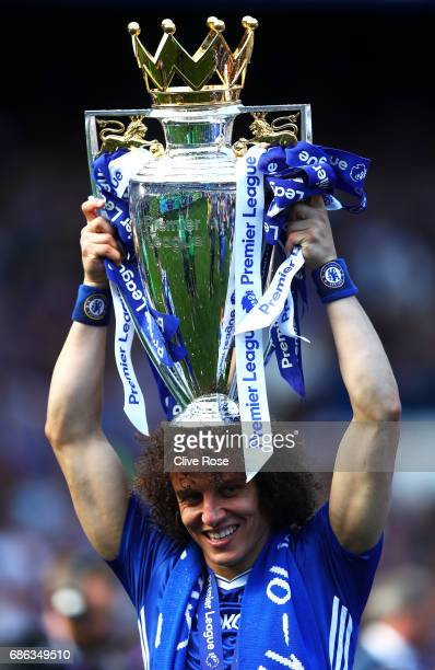 David Luiz of Chelsea celebrates with the Premier League Trophy after the Premier League match between Chelsea and Sunderland at Stamford Bridge on...