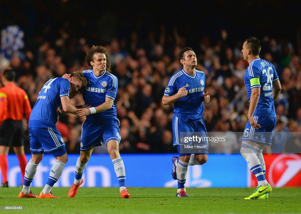 David Luiz of Chelsea congratulates Andre Schurrle of Chelsea on scoring their first goal during the UEFA Champions League Quarter Final second leg match between Chelsea and Paris Saint-Germain FC at Stamford Bridge on April 8, 2014 in London, England.