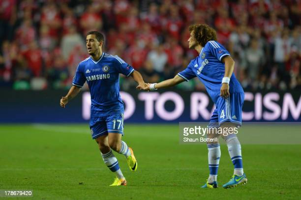 David Luiz of Chelsea congratulates Eden Hazard of Chelsea on scoring their second goal during the UEFA Super Cup between Bayern Muenchen and Chelsea...