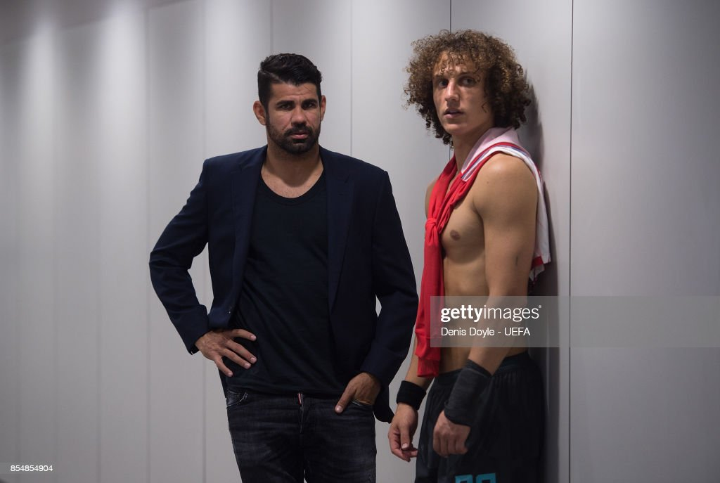 David Luiz of Chelsea FC chats with his teammate Diego Costa after the UEFA Champions League group C match between Atletico Madrid and Chelsea FC at Estadio Wanda Metropolitano on September 27, 2017 in Madrid, Spain.