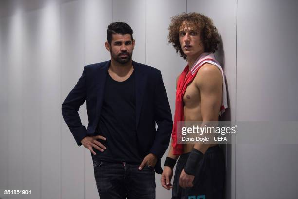 David Luiz of Chelsea FC chats with his teammate Diego Costa after the UEFA Champions League group C match between Atletico Madrid and Chelsea FC at...
