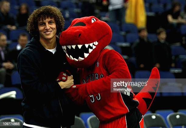 David Luiz of Chelsea FC poses for a picture with the Raptors mascot ahead the NBA match between New Jersey Nets and the Toronto Raptors at the O2...