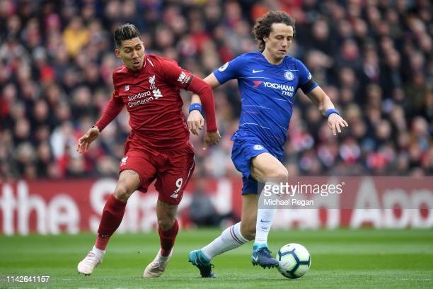 David Luiz of Chelsea holds off Roberto Firmino of Liverpool during the Premier League match between Liverpool FC and Chelsea FC at Anfield on April...