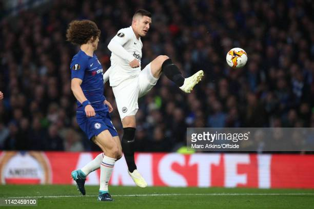 David Luiz of Chelsea in action with Luka Jovic of Eintracht Frankfurt during the UEFA Europa League Semi Final Second Leg match between Chelsea and...