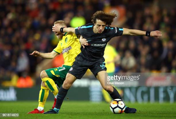 David Luiz of Chelsea is challenged by Alex Pritchard of Norwich City during The Emirates FA Cup Third Round match between Norwich City and Chelsea...