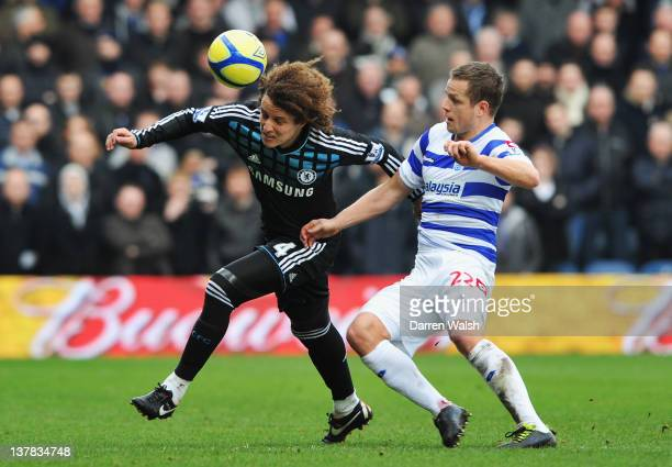 David Luiz of Chelsea is challenged by Heidar Helguson of Queens Park Rangers during the FA Cup with Budweiser Fourth Round match between Queens Park...