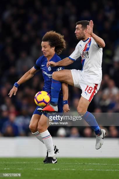 David Luiz of Chelsea is challenged by James McArthur of Crystal Palace during the Premier League match between Chelsea FC and Crystal Palace at...